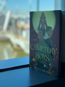 Cemetery Boys book sitting in a window sill