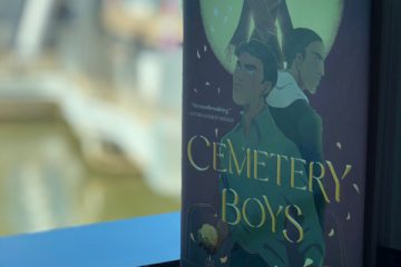 Cemetery Boys book sitting on a window sill